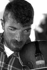 Fiddler on the ferry (maessive) Tags: portrait bw deleteme deleteme2 turkey saveme4 saveme5 saveme6 saveme savedbythedeletemegroup saveme2 saveme3 saveme7 istanbul saveme10 saveme8 saveme9 saveme11 maessive flickysblackandwhitephotography nicomaessen