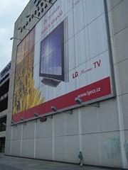 One day I'll grow up... (Niel.Deeper) Tags: prague boy billboard differentsize bigdifference bigboard