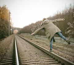 Balance (CoolMcFlash) Tags: person woman balance train rails rearview leadingline canon eos 60d tamron a007 2470 flickrfriday funny frau gleichgewicht schienen rückansicht outdoor fluchtpunkt austria österreich fotografie photography
