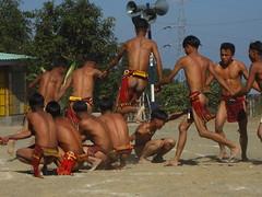 jumping over the fence (dibopics) Tags: india festival tribal assam hornbill kohima nagaland dances dimapur dibopics angami hornbillfestival chakhesang rengma pochury