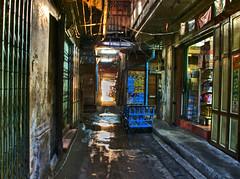 Dark alley at sunset (DanielKHC) Tags: sunset photoshop dark thailand alley bladerunner bangkok sony alpha wat pho hdr a100 3xp photomatix tonemapped sigma18200mm danielcheong hdrenfrancais danielkhc