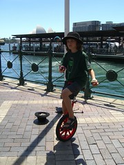 Caleb Unicycling on Circular Quay with Opera House in background