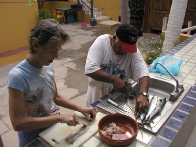 Beth and Javier prepare the fish