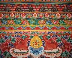 Lintel decoration in Gangteng Gompa - by brentolson