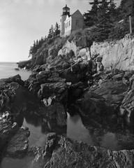 Pinhole Light (M J M) Tags: ocean camera bw lighthouse white black reflection film water rock harbor bass head tmax grain maine rocky wave pinhole timeexposure negative shore mjm gloss 4x5 100 tmx f256
