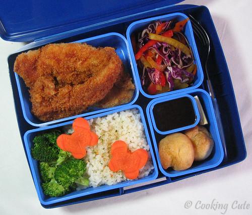 [laptop lunchbox with chicken katsu and tonkatsu sauce, veggie slaw, pastries, chocolate, veggies]