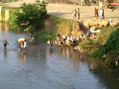 Carrying goods for the next day's market (Neenabeena) Tags: river haiti crossing massacre rivercrossing dajabon
