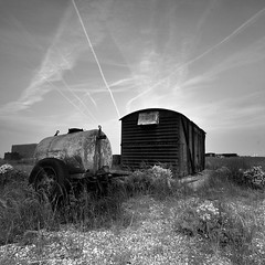Dungeness Fuel Tank (Adam Clutterbuck) Tags: uk greatbritain blackandwhite bw fish 20d beach monochrome square landscape mono coast blackwhite kent fishing tank shed canoneos20d bn minimal coastal shore elements gb dungeness shack trailer bandw simple sq oe tanker distilled simplified greengage adamclutterbuck sqbw bwsq showinrecentset openedition