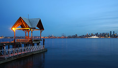 Watching the city at dusk.. (leuntje) Tags: vancouver britishcolumbia northvancouver northshore waterfrontpark pier canada bluehour evening burrardinlet canadaplace cityscape skyline