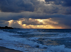 Beams of Light (esther**) Tags: blue light sunset sea sky beach yellow clouds bravo waves hellas 2006 greece topf100 rhodes sonydsch5 abigfave anawesomeshot raziks20