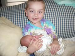 Nicholas holding baby