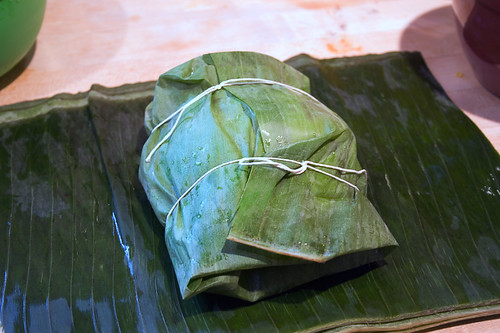 Wrap tamal up in banana leaves and tie with string