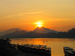 Mekong sunset (Danil) Tags: travel sunset mountain beautiful river boat asia laos mekong luang prabang