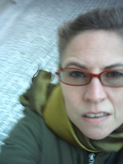 it WAS a VERY windy day (Ladybadtiming) Tags: red selfportrait green me face glasses wind bodylanguage s frown