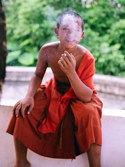 smoking Novice (shigueo_br) Tags: film kids youth 35mm children kid cigarette smoke cancer documentary monk kinder smoking teen smoker laos wat tabak luangprabang sigaret underage raucher tabacco zigarette fumo rauchen fumare kippe nikotin lungenkrebs tutun childrensmoking fumeaza kinderrauchen