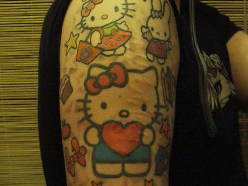 My boi's hello kitty tattoos are rare as I have not seen any before: Comment
