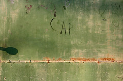Cap (sonofsteppe) Tags: street door old city shadow urban abstract detail green art texture metal town rust gate iron paint hungary suburban metallic painted tag grunge budapest rusty surface explore cap rusted simplicity weathered material abstraction aged sunlit simple sunbeam obsolete scribbled greenandrust sonofsteppe haphazartgrunge haphazartmetal haphazartgreen