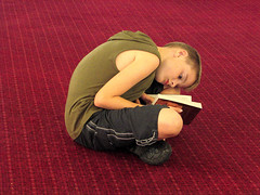 Boy Reading on a Red Carpet, Pride of Bilbao F...