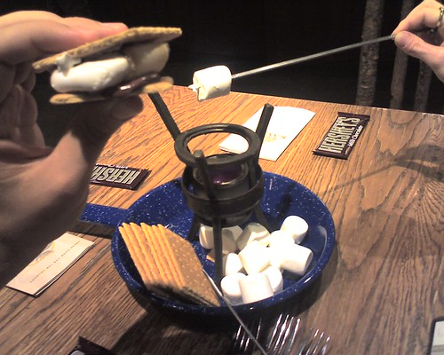 Toasting s'mores at Kayaks Coffee