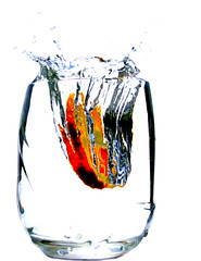 splash (EssjayNZ) Tags: newzealand orange water glass tag3 taggedout 1025fav 510fav cool tag2 tag1 2550fav 50100fav citrus splash essjaynz 2007 1111v11f 50faves 20faves interestingness22 i500 25faves superaplus aplusphoto 200750plusfaves taken2007 ymiweek22winner sarahmacmillan
