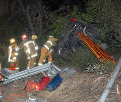 Firefighters Render Care to Injured. Photo by Mike Meadows. Click to view more...