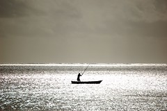 Lonely Fisherman (EricK_1968) Tags: africa mer holiday nature water silhouette boot mar fisherman meer solitude barca mare barco kenya wildlife 2006 solo soledad bateau pcheur pesca sola navegando fischer pescador pescatore solido seul s einsam pche solitudine wow1 wow2 sozinho fischen isole allein    navigante  lonelyfisherman  naviguant erick1968 mygearandmepremium mygearandmebronze mygearandmesilver mygearandmegold    segelndeinsamkeit flickrstruereflection1
