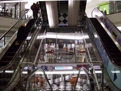 Escalators at the downtown Ottawa Hudson's Bay Company department store. (Steve Brandon) Tags: city people ontario canada reflection shop retail geotagged store downtown magasin ottawa postoffice departmentstore escalators hbc thebay ville shoppers centreville clients customers rideaustreet canadapost hudsonsbaycompany  labaie rideaust  postescanada bureaudeposte  ottawaphotography  thehudsonsbaycompany magasinrayons lacompagniedelabaiedhudson ruerideau freimanmall pharmamart   ottawaphotographer