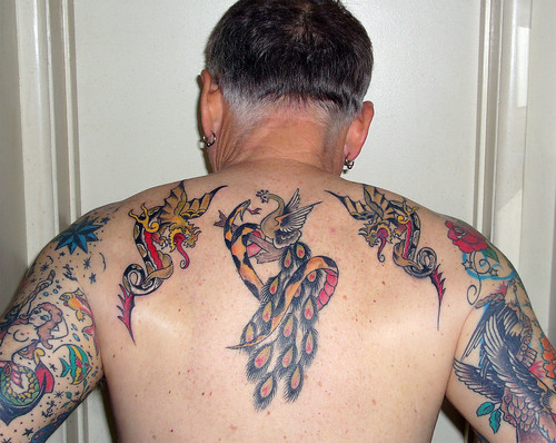 The tats are Sailor Jerry Flash designs of dragons and an intertwined snake