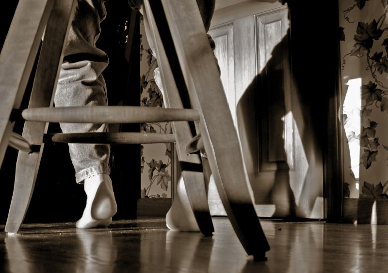 a chair a heel the shadows