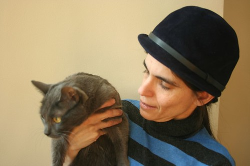 Self portrait with vintage hat and unwilling cat