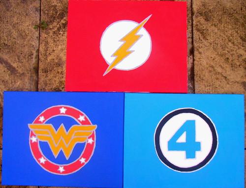 Three Superhero Logo Paintings