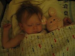 Madelyn sleeps with her bunny