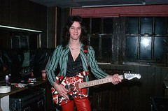 Eddie Van Halen 1979 (Taylor Player) Tags: people music playing man men smile smiling musicians portraits person photography 1 alone expression colorphotography performingarts guitars rockmusic instrument americans famouspeople males northamericans personalities prominentpersons whites eddievanhalen van cheerful adults halen guitarists rockandroll oneperson guitarplayer vanhalen individual musicalinstruments caucasian stringedinstruments facialexpressions onepersononly halflengthportraits halflengthportrait musicalinstrumentplaying electricguitars