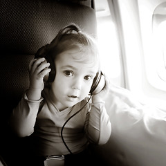 home-ish (sesame ellis) Tags: blackandwhite girl square airplane kid toddler child flight mykid headphones qantas year3 warmtone hip2bsquare racheldevine wwwracheldevinecom