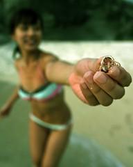 hermit crab season. (theshanghaieye) Tags: ocean sea sexy beach girl lady hermitcrab sand surf dof tide philippines fingers longhair shell crab bikini tropical shaun kimmy tropics swimwear zambales showandtell bodyofwater