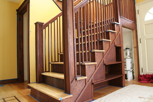 The Lower Stairs With Newel Posts, Railing, And Shelves.