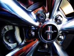 mustang rim detail (atomicshark) Tags: detail macro ford wheel closeup aluminum fuji muscle machine bestviewedlarge f30 pony finepix bolts brake mustang gt rim mecha polished musclecar 2007 lugnuts rotor ponycar fomoco caliper machined fordmustanggt atomicshark p1f1 superaplus aplusphoto
