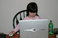 Child on Laptop by Flickr user G.Mai
