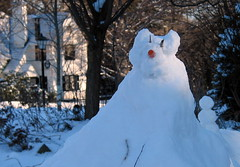 Snow cat with snow man on back.