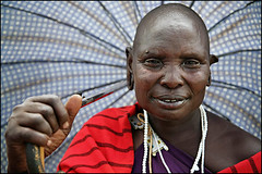 a woman with umbrella - Tanzania (Maciej Dakowicz) Tags: africa travel portrait people woman tourism umbrella canon tanzania african mother tribal exotic 5d masai maasai steppe arusha ostrellina