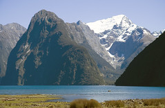 Milford Sound  - Majestic Scale (f0rbe5) Tags: blue sea newzealand white mountain snow plane boat 2006 sound southisland geology milfordsound aotearoa glacial fjordland oceania weathering mountpembroke geological glaciation