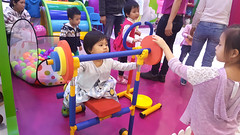Gym baby (Roving I) Tags: weights gym babies girls events promotions colour nappies nappy diapers vincomcenter shoppingmalls retail danang vietnam