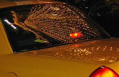 Christmas lights, NYC. 06 (ho_hokus) Tags: newyorkcity newyork reflection manhattan taxi 2006 midtown macys merrychristmas heraldsquare christmas2006 christmasnewyork macysnewyork