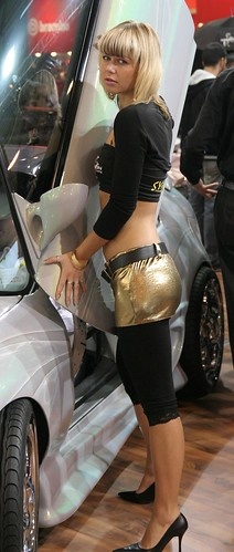 Cars show model in silver shorts