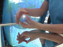 healing hands over mirror, Charlotte Stuart of Stillpoint Acupuncture, in New Zealand
