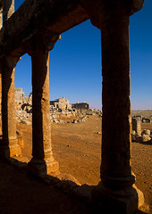Dead City Of Serjilla, Syria (Eric Lafforgue) Tags: travel house color colour vertical horizontal stone architecture dead outdoors photography ancient day village roman middleeast bluesky nopeople explore arabia syria thepast hama aleppo 172 middleeastern siria  levant syrien syrie deadcity sirja traveldestinations colorimage suriye   syri oldruin lafforgue alzawiya serjilla  sergilla ericlafforgue sria szria lafforguemaccom mytripsmypics thedeadcities ericlafforgue serdjilla builtstructure  westernasia    suriah sirija  cp  sora alzawiyamountain