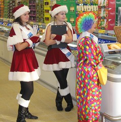 Saturday Shoppers (Heaven`s Gate (John)) Tags: christmas xmas girls red white clown santaclaus multicolour blacktights johndalkin heavensgatejohn