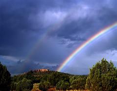 double rainbow over sedona (jody9) Tags: arizona sky topf25 mediumformat landscape rainbow sedona stormy redrocks pentax6x7 impressedbeauty