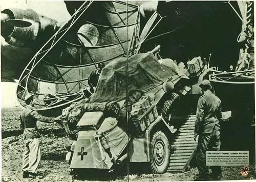 TP.082 - S.D.K.F.Z. 222 being loaded in to nose of Me.323, German