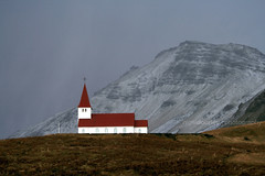 The Church at Vik (Nigel Dourley) Tags: green architecture canon landscape grey iceland ancient europe religion vik explore top20 norse scandanavia utatafeature 400d ifimages 2008calendar diamondclassphotographer flickrdiamond nigeldourley cornishphotographer